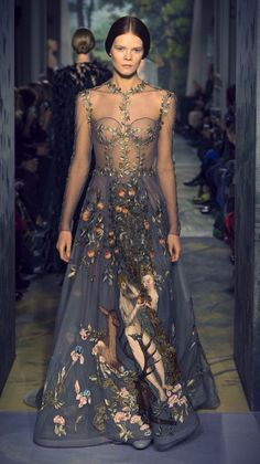 """This Valentino couture dress, depicting German Renaissance painter Lucas Cranach's Adam and Eve, is INSANE. girlannachronism:  Valentino spring 2014 couture collection- """"Le jardin d'Eden"""", a zirconium-colored tulle dress, embroidered in silk threads, with a sceneof Adam and Eve in the Garden of Eden inspired by the painting """"Adam and Eve"""" by Lucas Cranach in 1526, taking 2,200 hours to hand embroider."""
