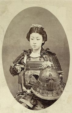 Vintage photograph of an onna-bugeisha, female samurai warrior of the upper bushi (samurai), class in feudal Japan. Late 1800's.