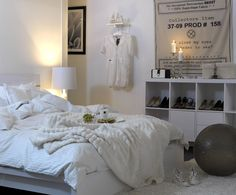 All white bedroom, not realistic in my house but very cpmfy looking