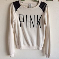 Price drop NWOT VS PINK crew neck sweatshirt White with black faux leather shoulders. NWOT. Has been safely hanging in my closet since 2010ish. No rips or stains. In excellent condition. Oversized pullover fit. Will fit a small as well. Offering a 20% discount on 3+ item bundles for a limited time, ask and discount will be applied! Pair with the Gianni Bini black mini skirt to finish the look! Lowest unless bundled. PINK Victoria's Secret Tops Sweatshirts & Hoodies
