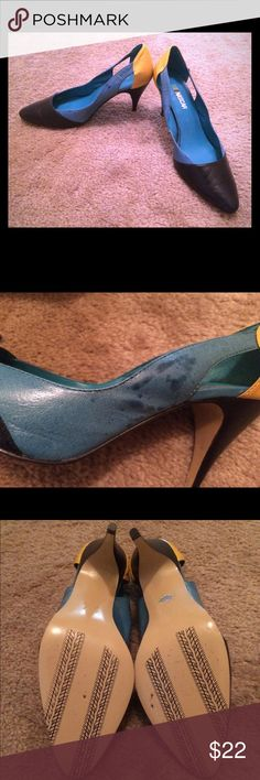 NASCAR heels: Size 8 🏁 Whether you're a NASCAR fan or you just like the black/turquoise/yellow color scheme, these heels are sure to turn heads! I bought them at an estate sale but never wore them. I attempted to polish them, which unfortunately discolored part of the turquoise sections (see photo). The soles show race car tire tracks and look nearly new. Please let me know if you have any questions! NASCAR Shoes Heels