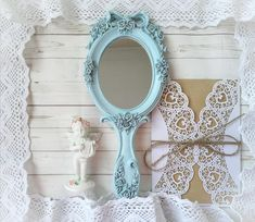 Vintage white hand Mirror with shabby chic Ornaments!!! Victorian blue antique carved mirror an elegant gift for every woman! The surfaces are pleasant to the touch, covered with acrylic varnish. Mirror also makes a stunning photo prop for the brides wedding and a unique and thoughtful bridal shower gift! Painted & distressed to look worn & vintage. A mirror is done in style of Shabby chic .Hand structural painting. It is non-toxic and resistant to mechanical damages. Shabby Chic Wedding Decor, Shabby Chic Frames, Vintage Decorations, Wedding Decorations, Wedding Ideas, Thoughtful Bridal Shower Gifts, Shabby Chic Ornaments, Blue Vanity, Vintage Photo Frames