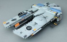 The YT-1450 model was conceived mainly for hauling large cargo crates by connecting them to the hull between the two forward mandibles. This was a feature not frequently used on earlier models, such as the YT-1300, but there still existed a market demand for these types of ships. The YT-1450 standard model comes equipped with a forward pointing tractor beam projector, placed between the large mandibles. Somewhat unique for this YT model is the side mounted rotating cockpit that gives the…