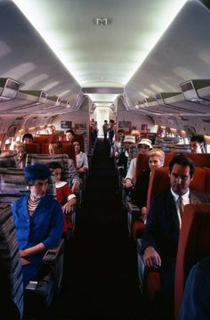 Convair 880 TWA First Class cabin. In service, the area behind the dividers was actually a 2-3 economy section, but for some reason this aircraft is configured 2-2 all the way through. This is a pre-service publicity shot taken in LA or San Diego.