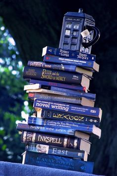 """I like this picture for vague and undefined reasons. Maybe it's because I own that mug and a plurality of those books. Can you even use """"plurality"""" in this situation? Whatever. I just did. Anyway. I like it.----"""