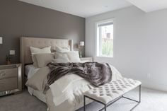 """""""I love the richness of the bedding and colors in the master bedroom,"""" says Hannah. We think most of that rich texture comes from the faux fur."""