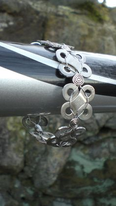 Bicycle chain links woven together to make a bracelet.