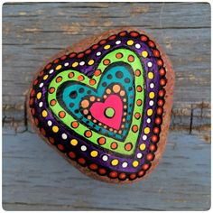 Hand-painted heart-motif river stone, one of a kind. Approx 2 1/2 x 2 1/4. Each piece is signed on the back Made with love by Tamara Page, 1