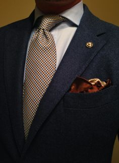 combination of navy jacket, shirt, tie and pochet. all in one