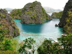 Coron is a Philippine municipality in the province of Palawan . According to the census of 1 May 2000 it has 32 residents in 6264 households. The Municipality of Coron is a part of the island of Busuanga and all […] Places Around The World, Oh The Places You'll Go, Places To Visit, Around The Worlds, Coron Palawan Philippines, Philippines Travel, Palawan Island, Exotic Places, By Train