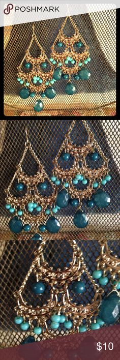 Turquoise chandelier earrings I'm in love with these! Gold filigree chandelier with dark and light turquoise beads really go with almost anything. 3.5 inches long and not very heavy. Thank you for looking!! ❤️❤️offers always considered and don't forget the bundle option ❤️❤️❤️ Francesca's Collections Jewelry Earrings