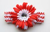 "This precious little 1.5"" white and red stripe crochet headband has a big 4"" beautiful solid red and white daisy.  Super cute for the holidays and great for pictures!!  We used our Designer Daisy Flower ""Sophie"" and added personality to it with a fun headband.  Sophie flower sell  individually and by dozen.  $1.99 at Wholesaleprincess.com"