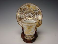Antique hand painted gilt porcelain cup and saucer set by Dresden, Germany c. 1900