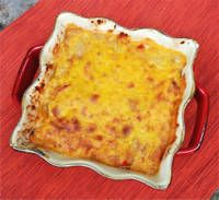 Traditional Chilean pastel de choclo is a fantastic casserole of seasoned beef, raisins, and olives (similar to the filling for the famous Chilean empanadas de pino), topped with a thick layer of creamed corn.