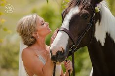 The Bride and the gorgeous horse with it's own 'hair' flower! By Dan Childs at 222 Photographic Studios, Queenstown, New Zealand. #nzweddingphotography #queenstownwedding