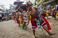 Indonesian Javanese Christians children perform traditional dance during the Rainwater ritual known as 'Ngunduh Hujan' as part of community of slope mount merapi celebrate Christmas on December 25, 2013 in Klaten, Central Java, Indonesia. The ritual is performed to grateful for the blessing of rain water that has been given by nature to the community of slope mount merapi for decades.