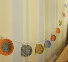 This would look adorable in her room.  Crocheted bunting!