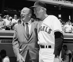 In this 1966 photo, Walt Disney attends the California Angels first regular season home game at their new home in Anaheim. Here he poses with Angels manager, Bill Rigney.