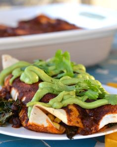 These Black Bean and Kale Enchiladas with Avocado Cream are vegan and ...