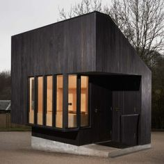 NORD Architecture completes charred timber gatehouse for National Trust estate