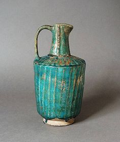 Ewer Iran Ewer, 12th or early 13th century Ceramic; Vessel, Fritware, monochrome turquoise glaze, Height: 10 in.