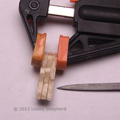 Dollhouse miniature table legs clamped together to be filed to final shape. - Photo © 2013 Lesley Shepherd
