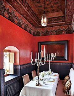 Love the rich colors and decorative ceiling in this renovated Moroccan riad.  SOURCE: Architectural Digest.