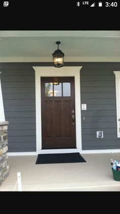 Front Door Colors For Grey House Dark Wood With White Trim And Blue Grey Siding Front Door With Windows, Blue Color Of House With White Trim House Siding, House Paint Exterior, Exterior House Colors, Exterior Doors, Exterior Door Trim, Gray Exterior, House Trim, Exterior Remodel, Exterior Design