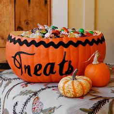 Candy Treasure Trove..Be ready for trick-or-treaters with this special Halloween bowl. Make the decoration: 1. Cut off the top of an artificial pumpkin. 2. Embellish the pumpkin with rickrack, and spell out the word treats in a fancy script using paint. 3. Fill the pumpkin with an array of sweet treats for your guests or trick-or-treaters.