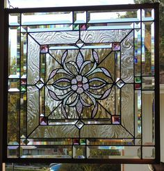 Beautiful Stained Glass Window Hanging ... measures 23 1/2 square ..... ..Polished .Brass Frame (edging).......custom orders are what I