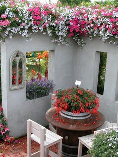 For Love of Outdoor Spaces - Love this idea. Create a cozy corner with windows. Love the flowers cascading down from the top, the mirror and flower box on the window ledge. Outdoor Rooms, Outdoor Gardens, Outdoor Living, Outdoor Decor, Beautiful Gardens, Beautiful Flowers, My Secret Garden, Secret Gardens, Flower Boxes
