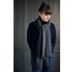 Moss Stitch Scarf: A wide moss stitch scarf made from fine Scottish lambswool. Designed by Freight and manufactured in England. We have chosen the finest wool to produce the best quality products possible. The scarf is wide enough to be worn as a shawl or tied simply as a scarf. It is designed for both men & women. A horn pin has been used in the photo to secure the scarf around the shoulders like a shawl.