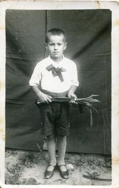 ON SALE Little 1936 European boy with huge bow and bouquet of