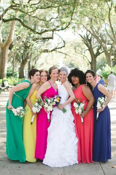 bright bridesmaid dresses - photo by The Schultzes http://ruffledblog.com/whimsical-and-colorful-wedding-in-savannah #bridesmaidsdresses #bridesmaids