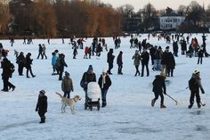 Thousands of people stay on the frozen Aussenalster river during the 'Alstervergnuegen' on February 10, 2012 in Hamburg, Germany. The very popular annual city festival 'Alstervergnuegen' takes place around the Alster lake in Hamburg. Last time the Alster was official approved for the 'Alstervergnuegen' is 15 years ago.