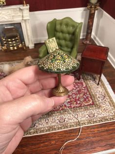 "Up for auction is a dollhouse miniature. This is an electric Tiffany style lamp by Barbara and Lew Kummerow. It measures 2-1/8"" in height. I just noticed the shade has 3 tiny holes. I never noticed this while photographing. Only when holding up into a light are they visible. Also, this does need a plug. 