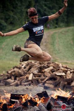 Team  Braveheart coach and a Spartan Chick doing work over the fire! #SpartanChicked #SpartanRace #GaspariNutrition www.spartanrace.com