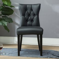 Add extra seating without sacrificing style with this handsome side chair. The dining chair features a sleek armless hourglass design and a sturdy frame with beautifully rounded legs