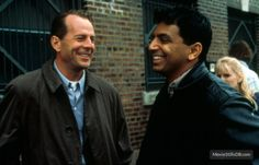 Bruce Willis and director M. Night Shyamalan on the set of The Sixth Sense (1999).