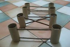 I wonder if I could use paper towel rolls and wooden dowels to make a cheap and easy agility course type thing...