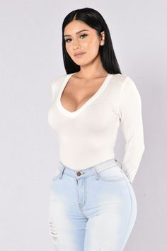 - Available in Charcoal, Black, and White - V Neckline - Long Sleeve - Cheeky Bottom - Snap Button Closure - ALL BODYSUITS FINAL SALE - Made in USA - 95% Rayon 5% Spandex