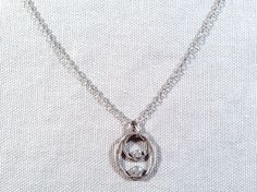 Handmade Necklace with Two Hammered Sterling Ovals with White CZ by J&I jewelry.