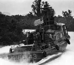 "Vietnam War - US Navy ""Swift Boat"" PCF men and weapons at the ready, proceeds at high speed into a Mekong Delta waterway. Vietnam History, Vietnam War Photos, Brown Water Navy, E Boat, Good Morning Vietnam, Us Navy Ships, North Vietnam, United States Navy, American War"
