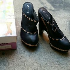 Sale ! Platform heels wood bottom clog NIB Leather Nicely made, feels luxurious. .thick cushion for comfort. .wood bottom insole , lining and upper are all soft leather. .soo comfortable. . Bottom sole is leather as well! Colors are black and cream.. new with box..no trades Violet Tash Shoes Mules & Clogs