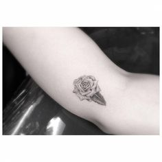 Small fine line style rose tattoo on the right forearm. Tattoo Artist: Dr. Woo