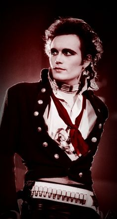 matching red make up and ribbon // THAT FUCKING VEST WITH THE GOLDEN BUTTONS it DESTROYS me // ribbed choker