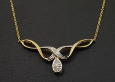 9ct Yellow Gold (0.15ct) Diamond Ribbon Necklace  https://www.jollysjewellers.com/product/9ct-yellow-gold-0-15ct-diamond-ribbon-necklace-micro-belcher-links-16-inch/