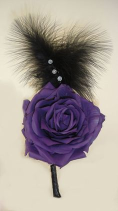 Rose button hole with feather
