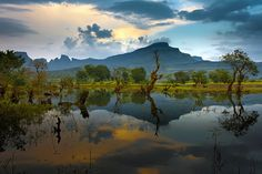 Reflections by Nitin  Prabhudesai -   Clicked this picture at Ghatghar, Maharashtra, India. Typical monsoon atmosphere with beautiful reflections in calm water.
