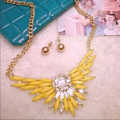 HOST PICK Statement jeweled  necklace/earrings Stunning in yellow! This beautiful statement necklace on a golden link chain brings a pop of color to everything. Brand-new with tags! Jewelry Necklaces